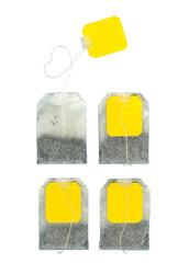 Four teabags on white background