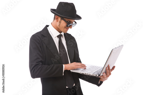 funny looking computer hacker with a laptop on white