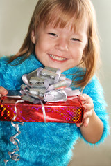 Very happy girl holding a gift box