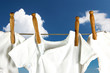 Baby laundry hanging on a line in the sky
