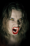 Young and hungry vampire on black background poster