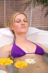beautiful woman having a water massage at the spa center