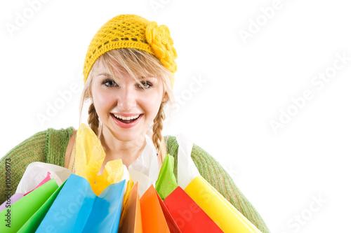 A beautiful caucasian girl carrying shopping bags