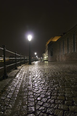 Night shot of wet cobblestone road in Maastricht, Netherland.