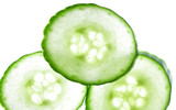 Three thin scices of green cucumber poster