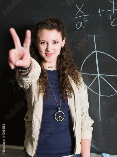 girl doing peace sign