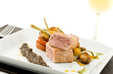 gourmet tuna dish with garnished vegetables and wine. poster