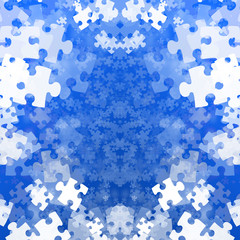 Random jigsaw pieces on a soft blue background