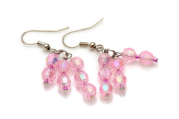 A pair of pink bead earrings isolated on white background.