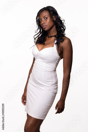 Attractive African American woman wearing tight white dress