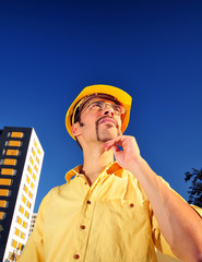 construction worker looking upward and thinking