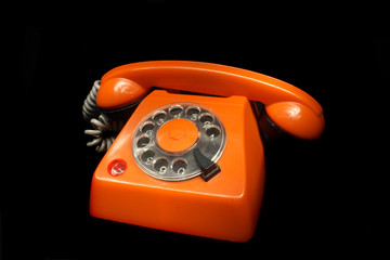 old orange phone on the black background