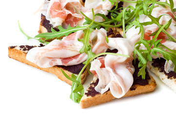 rocket salad and ham on the toasted bread