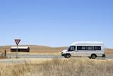 Camper van on its way in the desert in Australia poster
