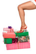 Ethnic Woman leg standing on pile of Christmas Gifts
