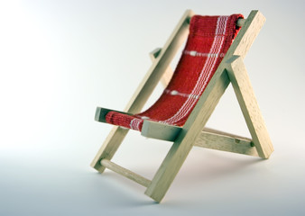 Toy chaise longue on white background