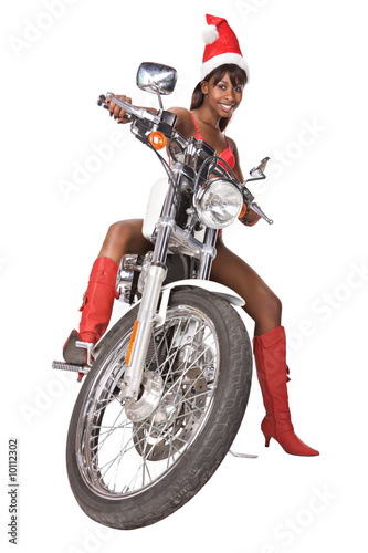 santa woman with long hair and red cap riding a bike,