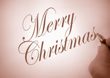 person writing merry christmas in calligraphy in sepia poster