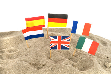 Beach in Europe with several Europe flags