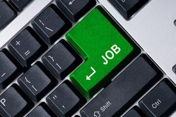 Personal computer keyboard with green key Job
