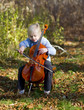 Child playing her cello outside on an October afternoon.