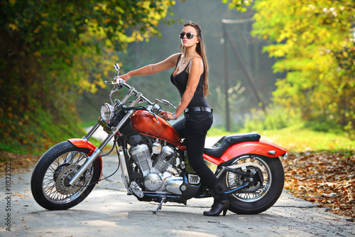 Attractive girl  on a motorbike - 10123522