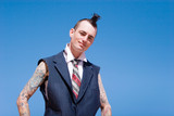 Man with mohawk style haircut and alternative fashion outfit poster