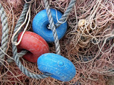 Detail os several buoys in a fishing net poster