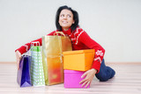 Glad lady indoors with gift shopping presents poster