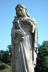 Sculpture of Jesus's Mother, holding cross and thorny crown