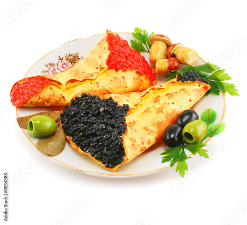 Dish with caviar-stuffed pancakes isolated on a white background