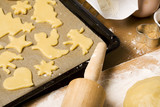 christmas cookies cut out of dough on oven rack, ingredients poster