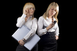 Two young businesswomen with laptop and phone. Isolated poster