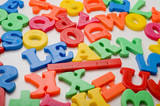 A colorful group of plastic letters spelling the word