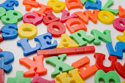 poster of A colorful group of plastic letters spelling the word learn.
