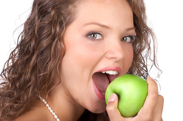 Beautiful young woman with a green apple. Isolated over white.