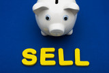 Piggy bank with letters spelling sell , investing your savings poster