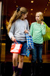 Two young children hanging around the streets while shopping