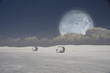 Surreal image with sleds and moon