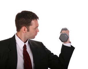 Businessman in dark suit lifting hand weight