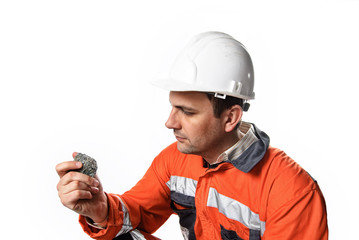 Mine engineer checking mineral isolated on white
