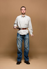 Young man with a belt tightened to the extreme