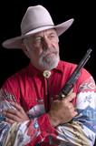 Old Cowboy holding a replica black-powder revolver poster