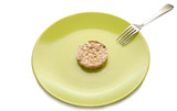 Green plate with cereal dietary pastry and fork