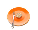 Orange plate with dietery pastry