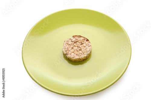 Strict diet. Green plate with cereal pastry
