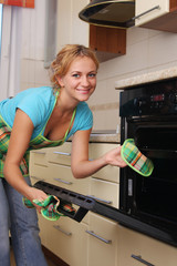 Girl cooks food in an oven