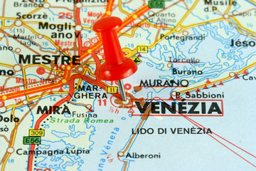 Venice (Venezia) in Italy. Push pin on an old map.