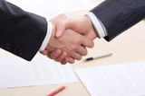 Business people joining hands together for deal poster
