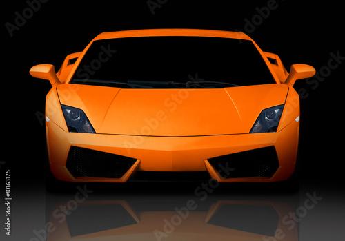 Bright orange modern supercar in studio. Front view. - 10163175